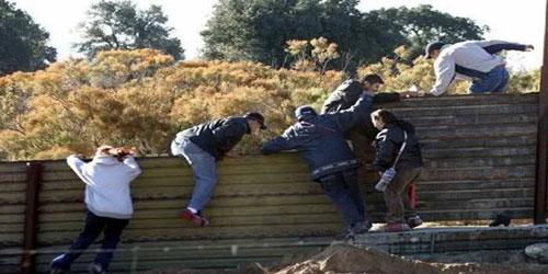 Border-Wall-hoppers-trump-maga-border-patrol-gop-democrats-liberals-conservative