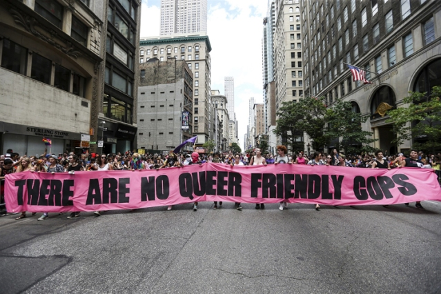 180622-pride-sign-no-queer-friendly-cops-ew-119p_eb88c28eb1fb2a0214abfab066c7deeb.fit-2000w.jpg